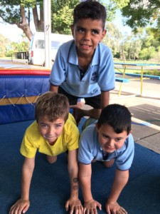 students practise circus tricks during school workshops